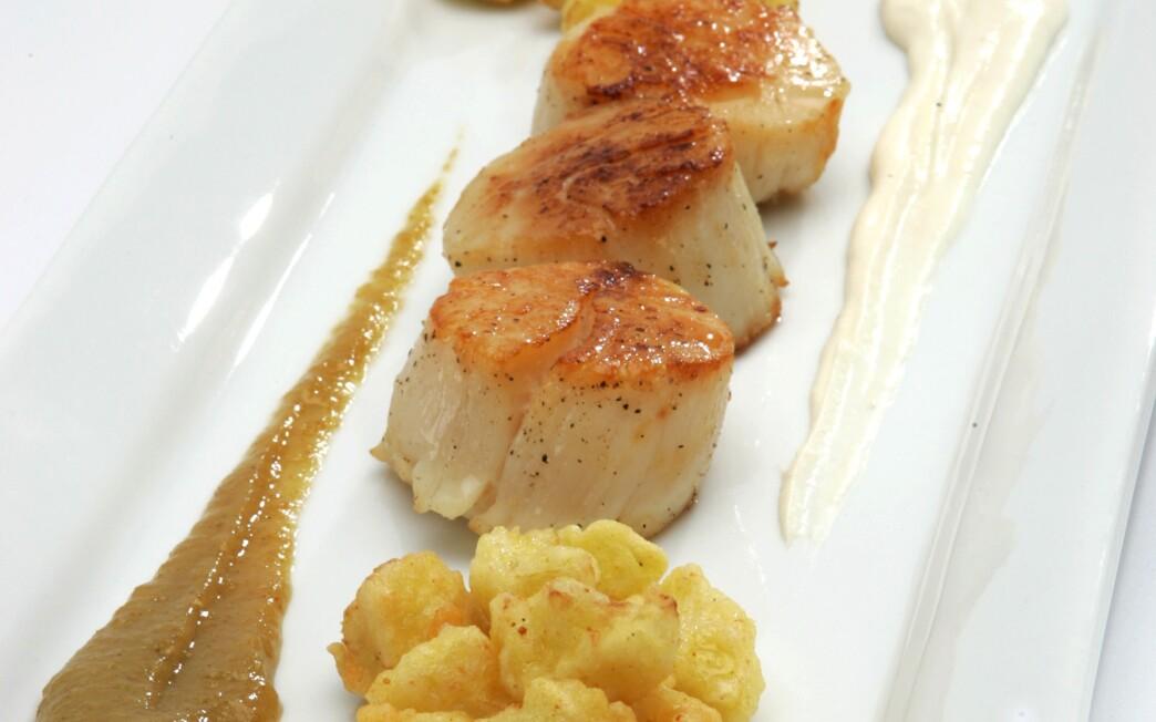 Cauliflower beignets with sea scallops and golden raisin puree