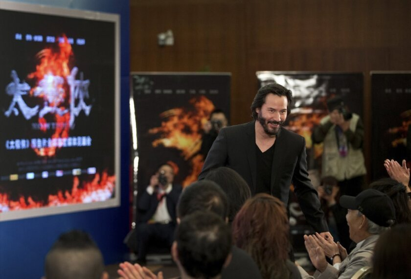"""Keanu Reeves makes an appearance in Beijing on Saturday to promote his new movie """"Man of Tai Chi"""""""