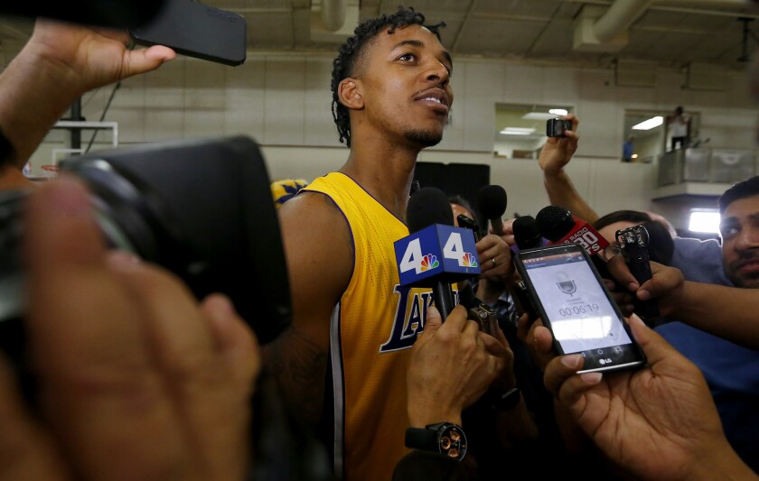Lakers guard Nick Young talks to reporters during the team's media day.