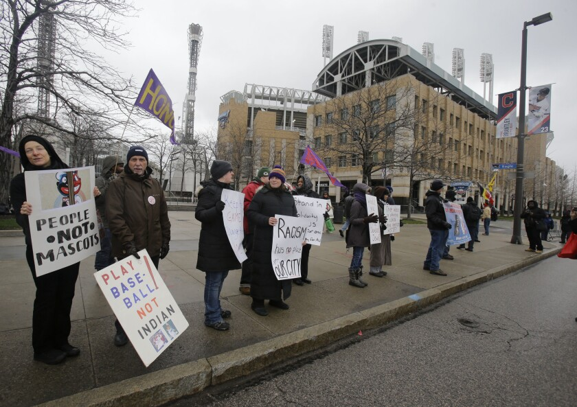 Protesters gather outside Progressive Field in Cleveland, Ohio to protest the Cleveland Indians' mascot on April 4.