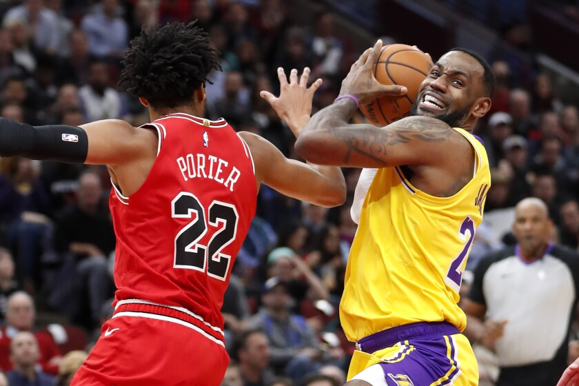 Los Angeles Lakers' LeBron James, right, drives to the basket past Chicago Bulls' Otto Porter Jr. during the first half of an NBA basketball game Tuesday, Nov. 5, 2019, in Chicago. (AP Photo/Charles Rex Arbogast)