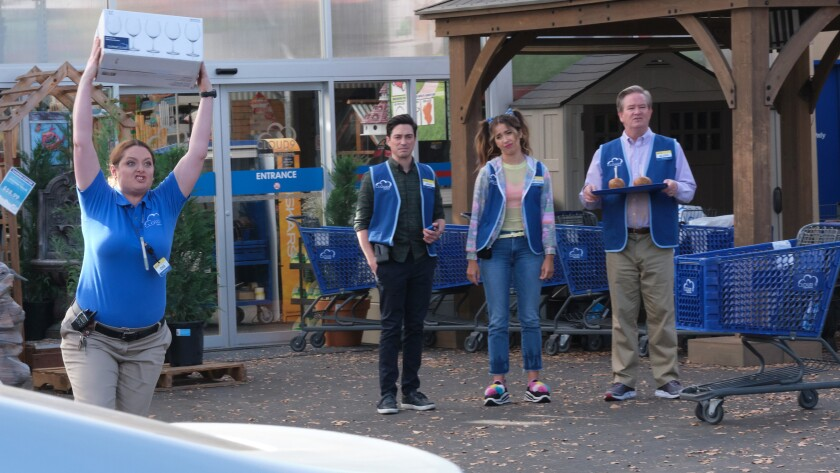 """Lauren Ash, left, Ben Feldman, Nichole Bloom and Mark McKinney in a new episode of the workplace comedy """"Superstore"""" on NBC."""