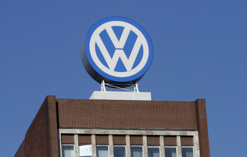 FILE - In this Feb. 24, 2011 file photo the Volkswagen logo is photographed at the company's headquarters at the Volkswagen plant in Wolfsburg, Germany. Automaker Volkswagen says Wednesday, April 29, 2015, that net profit rose to 2.93 billion euros (US dollar 3.23 billion) in the January-March quar
