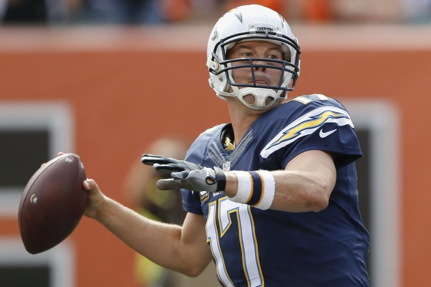 San Diego Chargers quarterback Philip Rivers throws in the second half of an NFL football game against the Cincinnati Bengals, Sunday, Sept. 20, 2015, in Cincinnati. (AP Photo/Gary Landers)