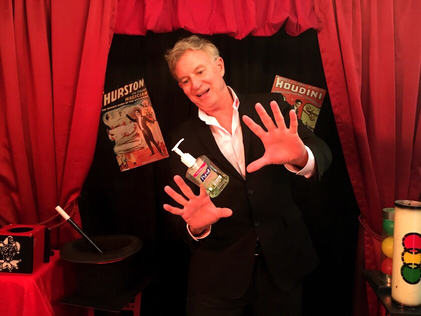 Dean Apple, 61, films videos to teach children how to perform their own magic tricks.