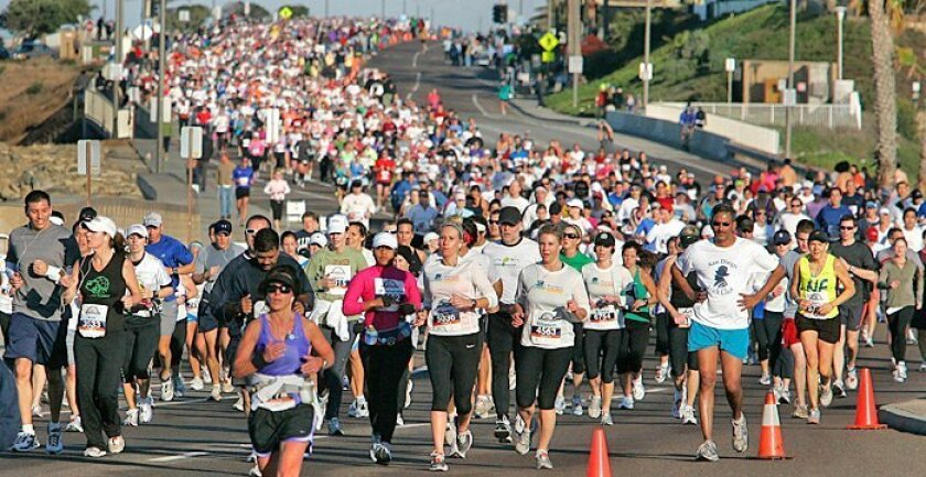 Runners race on Carlsbad Boulevard during the Carlsbad Marathon and Half Marathon. The sold-out event had 8,500 entries in the half marathon and 1,500 in the marathon.