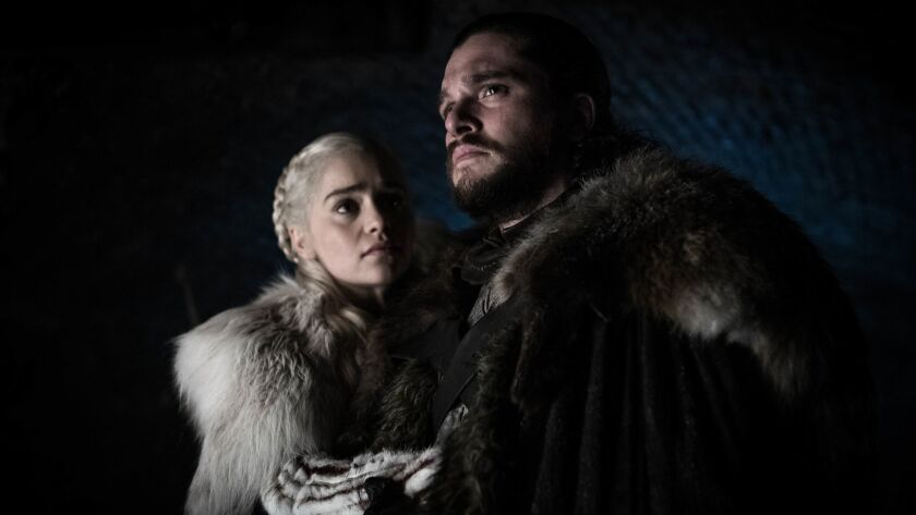 """This image released by HBO shows Emilia Clarke and Kit Harington in a scene from """"Game of Thrones,"""""""
