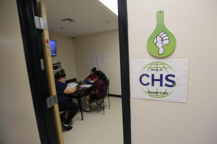 Migrant teens in their dorm room