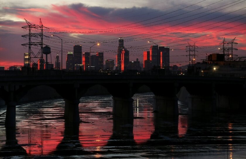 The Los Angeles River reflects late afternoon light as it flows beneath the Soto Street Bridge in Boyle Heights in this 2015 file photo.