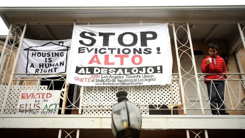 LOS ANGELES-CA-JANUARY 6, 2016: Anti-eviction signs decorate the Rodney Drive apartments in Los Feli