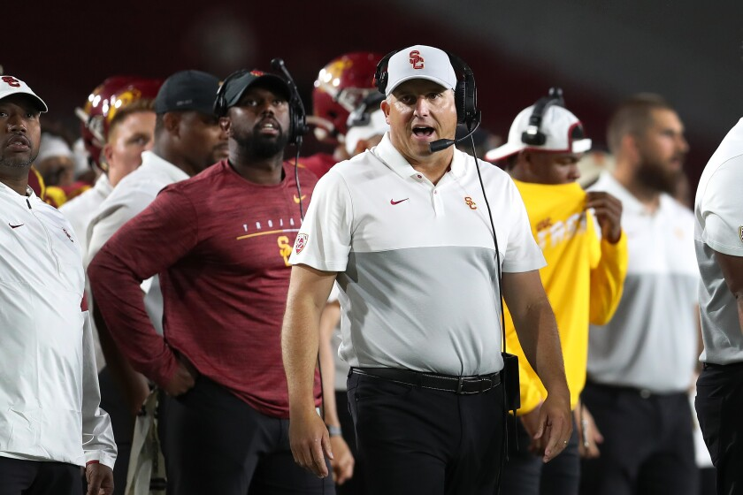 Is USC coach Clay Helton in danger of losing his job if the Trojans don't make the Pac-12 title game?