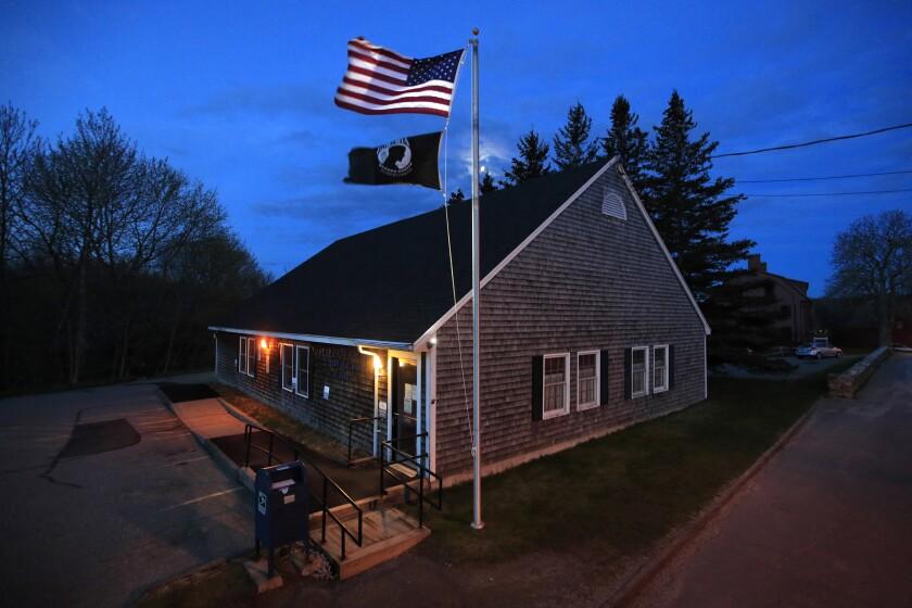New American flag flies outside post office on Deer Isle, Maine