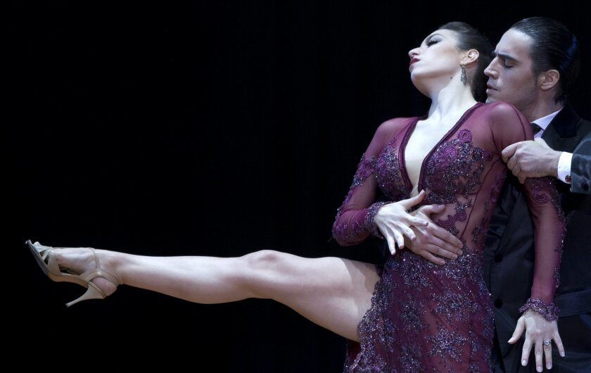 In this Aug. 26, 2014 photo, Juan Malizia Gatti and Manuela Rossi, from Argentina, compete during the 2014 Tango World Championship Stage category final, in Buenos Aires, Argentina. Gatti and Rossi won the championship. (AP Photo/Natacha Pisarenko)