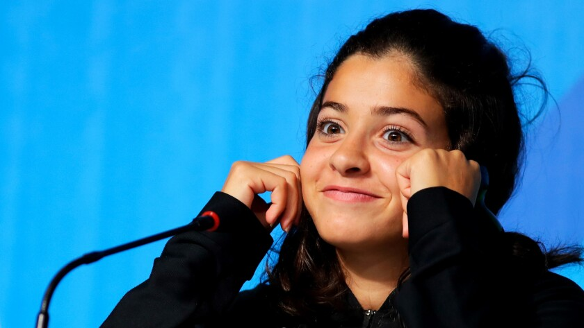 Syrian swimmer Yusra Mardini listens to a question during a news conference in Rio de Janeiro on Aug. 2.