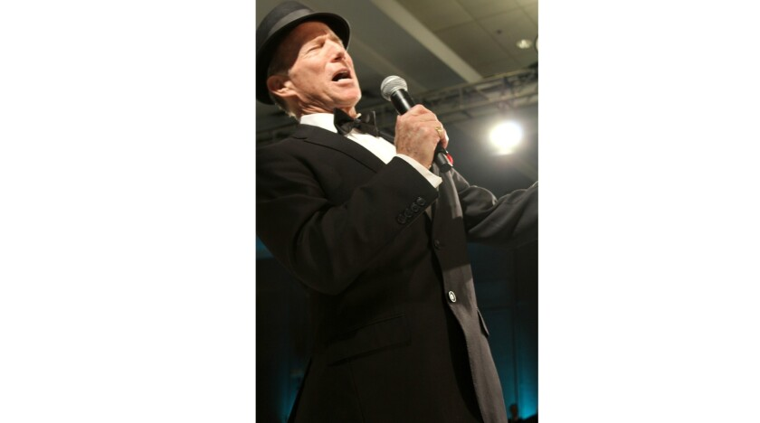 James Brewster, Frank Sinatra tribute artist, croons his way down the runway for Las Candelas. (