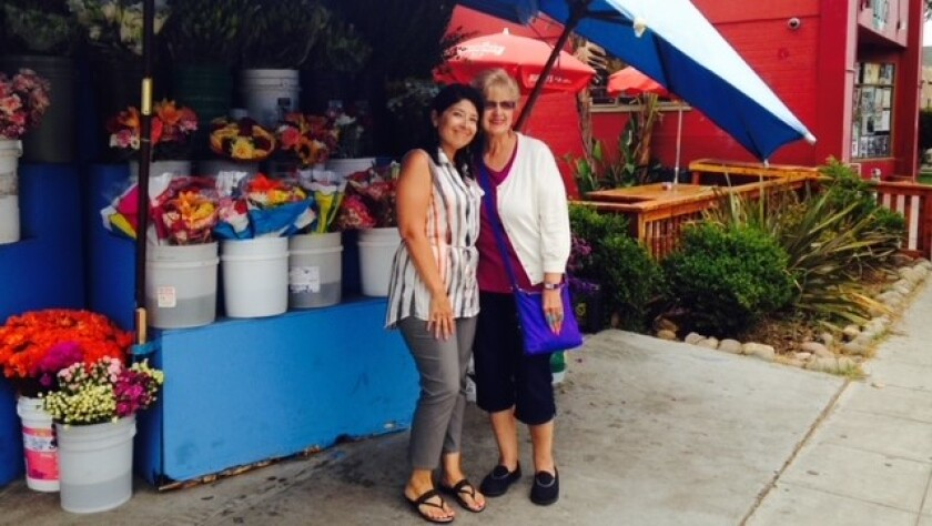 Laura Castañeda and her mother Anna Marie Castañeda at a flower shop in Golden Hill.