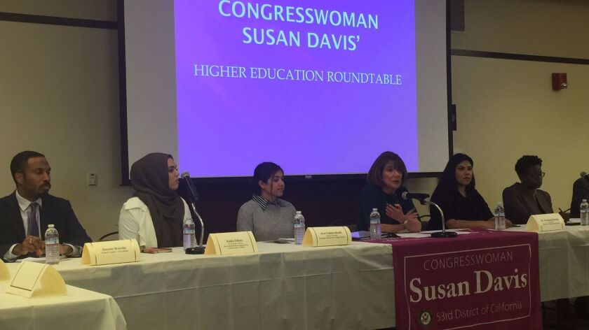 Congresswoman Susan Davis (at mic) lead a roundtable discussion among leaders from area colleges and universities at San Diego State University on Thursday.