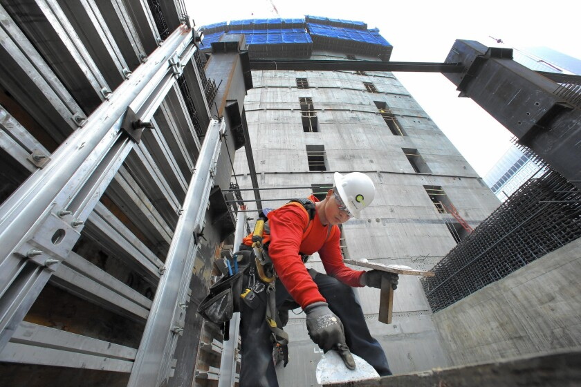 Carpenter Angel Diaz works on the Wilshire Grand Center last year in L.A.