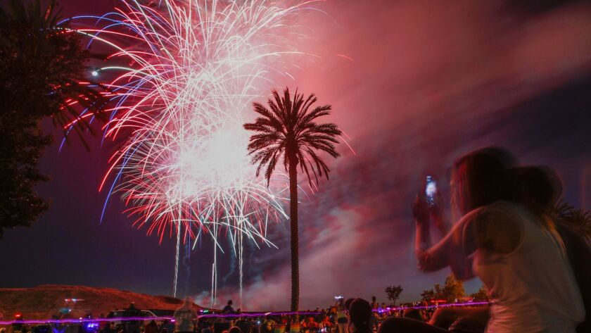 Spectators watch the fireworks display during the City of Oceanside's Fourth of July celebration on Rancho del Oro Drive.