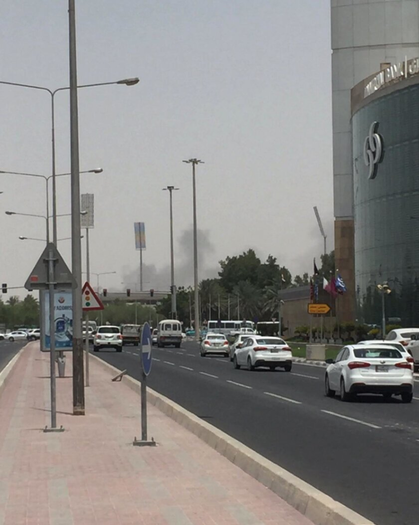 This picture posted on social media shows thick black smoke billowing from the Tawar Mall complex, Wednesday, July 20, 2016. Authorities say a fire has broken out at a shopping mall under construction in the country's capital, the second such blaze in the 2020 World Cup host nation in less than fou