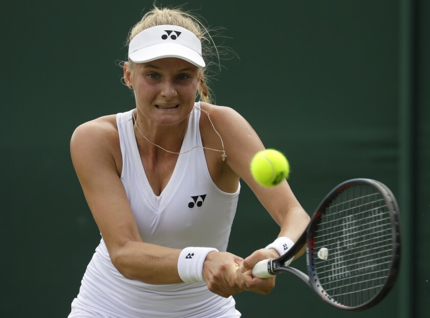 FILE - In this Monday, July 8, 2019 file photo, Ukraine's Dayana Yastremska returns the ball to China's Shuai Zhang in a women's singles match during day seven of the Wimbledon Tennis Championships in London. Australia. Top 30 tennis pro Dayana Yastremska has been suspended provisionally for failing an out-of-competition doping test, the International Tennis Federation announced Thursday, Jan. 7, 2021. Yastremska is a 20-year-old Ukrainian who is ranked 29th and reached the fourth round at Wimbledon in 2019. (AP Photo/Kirsty Wigglesworth, File)
