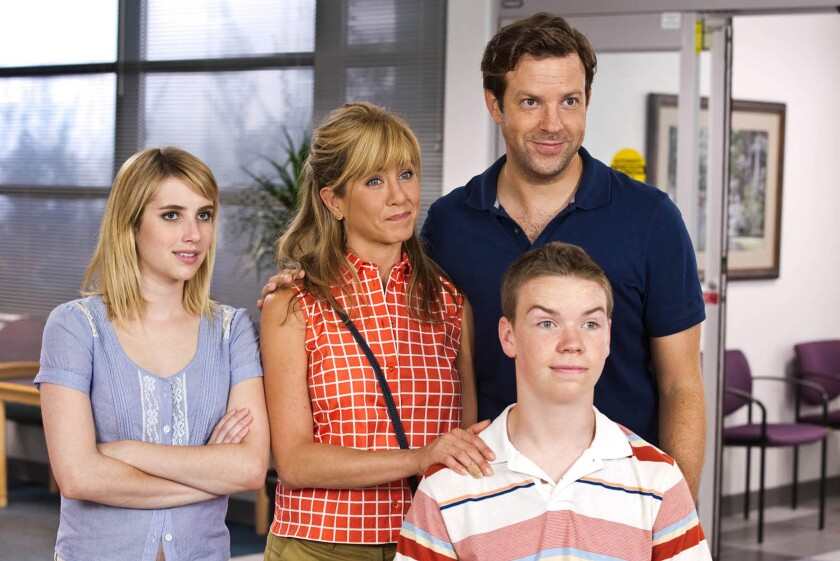 """Emma Roberts, Jennifer Aniston, Jason Sudeikis, background right, and Will Poulter in a scene from """"We're the Millers."""""""