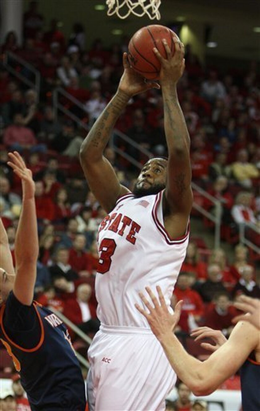 North Carolina State's Tracy Smith (23) shoots against Virginia during the first half of an NCAA college basketball game on Saturday Jan. 9, 2010, at the RBC Center in Raleigh, N.C. (AP Photo/The News & Observer, Ethan Hyman)