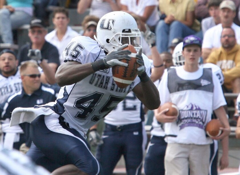 Utah State linebacker De'von Hall intercepts a pass from Wyoming quarterback Karsten Sween during a game on Sept. 8, 2007.