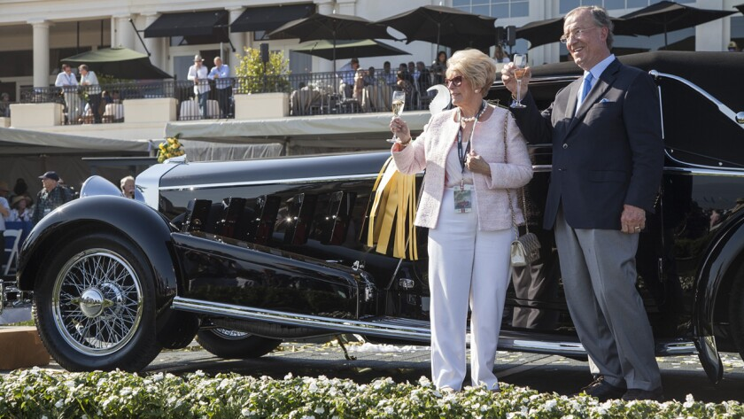 Jim and Dot Patterson lift a glass in celebration of their best of show win at the 65th Annual Pebble Beach Concours d'Elegance, for their 1924 Isotta Fraschini Tipo 8A.