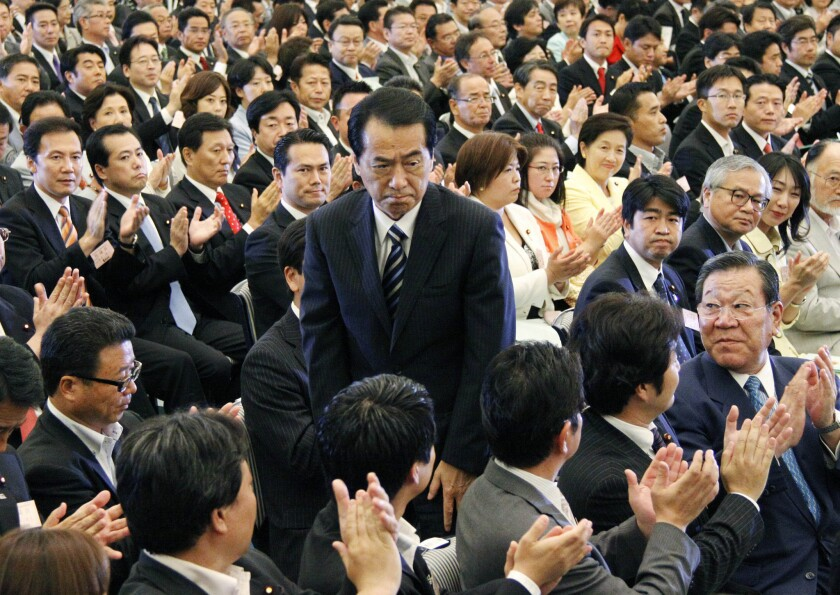 Naoto Kan stands to acknowledge his election as head of the Democratic Party of Japan at a Tokyo convention on Sept. 14, 2010. Kan was prime minister during the devastating March 11, 2011, earthquake, tsunami and nuclear accident at Fukushima. The disasters turned him against nuclear power on safety grounds, and he now spearheads the party's push to phase out nuclear production within the next 30 years.