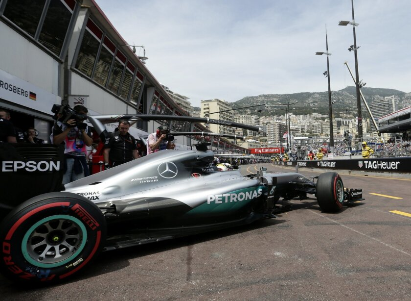 Mercedes driver Lewis Hamilton of Britain steers his car out of his team garage during the second free practice at the Monaco racetrack in Monaco, Thursday, May 26, 2016. The Formula one race will be held on Sunday. (AP Photo/Petr David Josek)