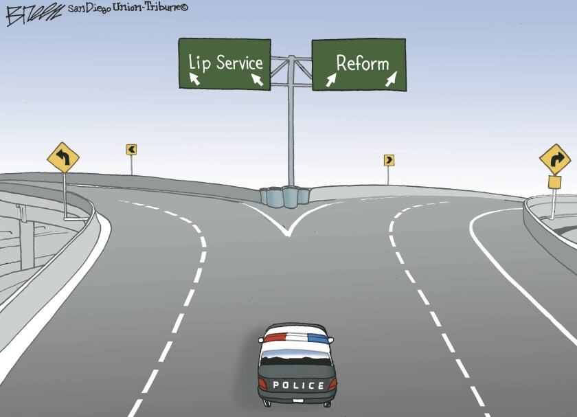 "A police cruiser sits at a fork in the road with ""Lip Service"" ahead on the left and the way of ""Reform"" on the right"