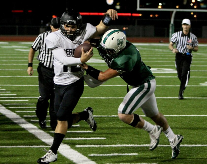 Defender Daniel Garcia of Oceanside drives Servite quarterback Cody Pittman out of bounds in last week's game. The Pirates, ranked No. 2 in the San Diego Section, host Temecula Chaparral at 7 p.m. Friday.