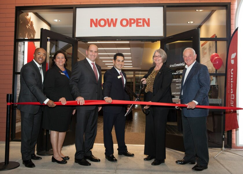 Union Bank executives, including Lawrence Henry, Marla Black, Mike Feldman and branch manager Ernesto Hernandez, Jr., join San Diego City Council President Sherri Lightner and San Diego Regional Chamber of Commerce President/CEO Jerry Sanders for a ribbon cutting Jan. 28 to celebrate the opening of