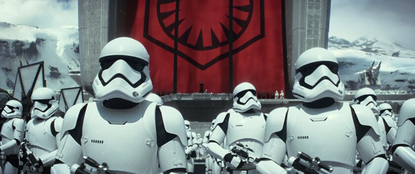 "This photo provided by Disney shows Stormtroopers in a scene from the new film, ""Star Wars: The Force Awakens."" The movie releases in the U.S. on Dec. 18, 2015. (Film Frame/Copyright Lucasfilm 2015 via AP)"
