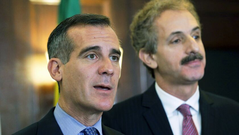 Los Angeles Mayor Eric Garcetti, left, and City Atty. Mike Feuer attend a City Hall news conference in 2016.