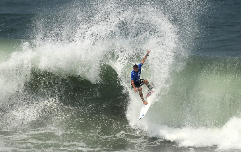 A surfer rides a wave Thursday during the ISA World Surfing Games at Surf City in El Salvador.
