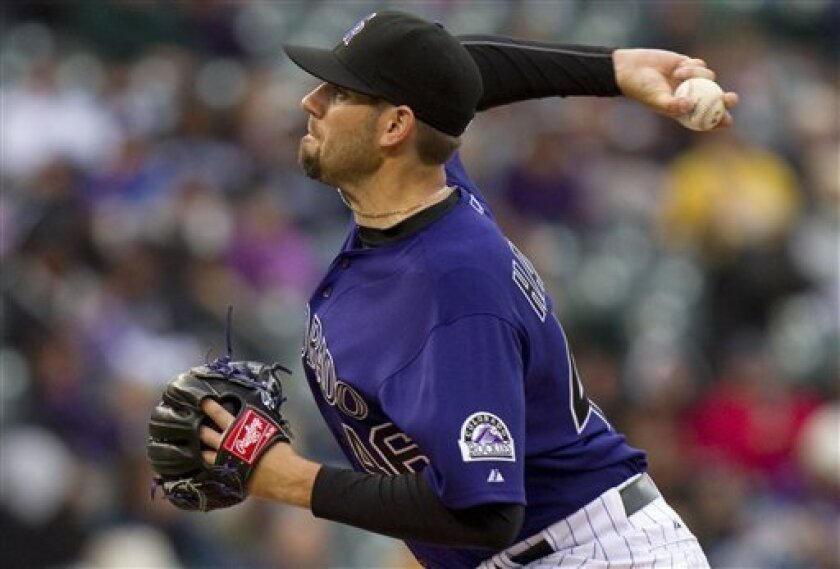 Colorado Rockies starting pitcher Jason Hammel (46) throws against the Pittsburgh Pirates during the first inning of a baseball game on Saturday, April 30, 2011, in Denver. (AP Photo/Barry Gutierrez)