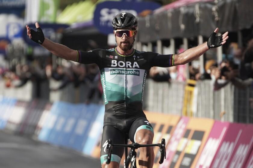 Slovakia's Peter Sagan celebrates as he crosses the finish line to win the tenth stage of the Giro d'Italia cycling race from Lanciano to Tortoreto, Italy, Tuesday, Oct. 13, 2020. (Gian Mattia D'Alberto/LaPresse via AP)