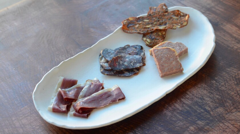 A small charcuterie plate from Gwen. In the center is the leek ash and porcini salami.