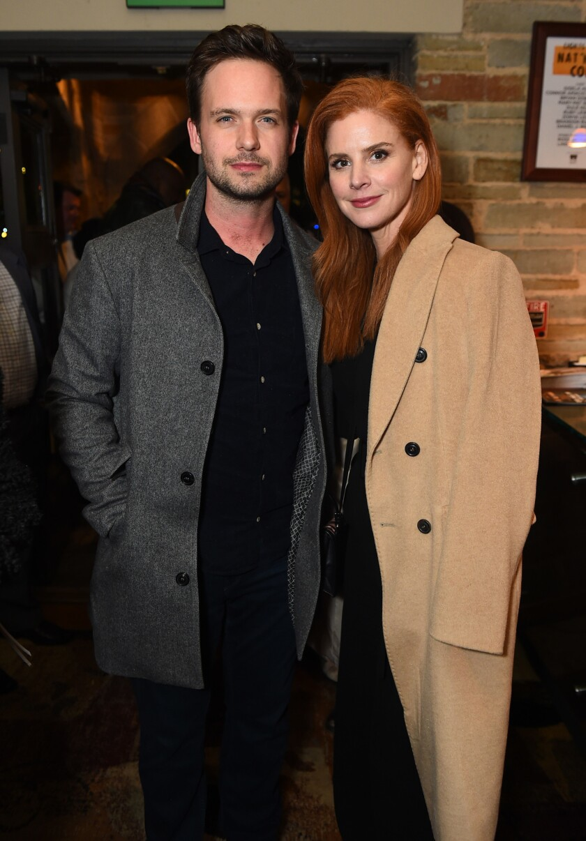 "Dulé Hill's ""Suits"" co-stars, Patrick Adams and Sarah Rafferty pose at the opening night party for"
