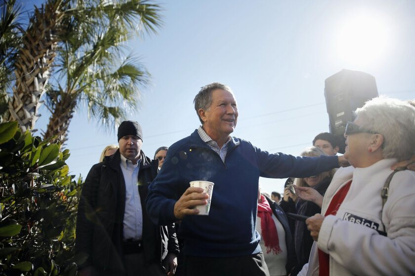 In this Feb. 11, 2016, photo, Republican presidential candidate, Ohio Gov. John Kasich meets with attendees during a campaign stop in Pawleys Island, S.C.  An energized Kasich heads into South Carolina's Republican presidential primary hoping to build on a strong showing in New Hampshire, but he's