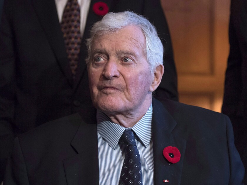 """FILE - In this Nov. 6, 2017 file photo, former prime minister John Turner looks on during a photo op to mark the 150th anniversary of the first meeting of the first Parliament of Canada, in Ottawa. Turner, whose odyssey from a """"Liberal dream in motion"""" to a political anachronism spanned 30 years, has died at the age of 91. Marc Kealey, a former aide speaking on behalf of Turner's relatives as a family friend, says Turner died peacefully in his sleep at home in Toronto on Friday, Sept. 18, 2020. (Justin Tang/The Canadian Press via AP)"""