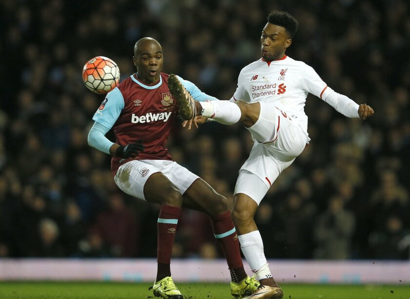 West Ham's Angelo Ogbonna, left, vies for the ball with Liverpool's Daniel Sturridge during the English FA Cup fourth round replay soccer match between West Ham United and Liverpool at the Boleyn Ground stadium in London, Tuesday, Feb. 9, 2016. (AP Photo/Kirsty Wigglesworth)