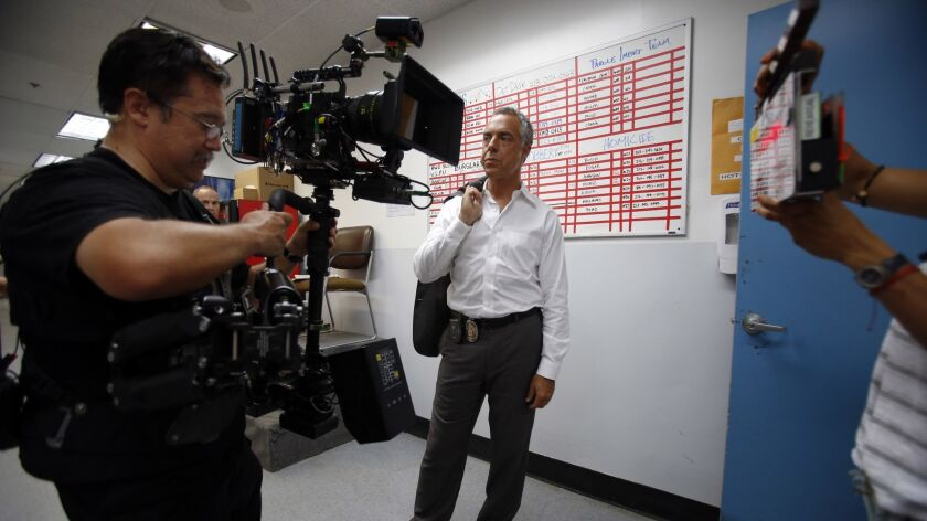 HOLLYWOOD, CA - SEPTEMBER 2, 2014: Steady cam operator Kenji Luster, left, Actor Titus Welliver, mid