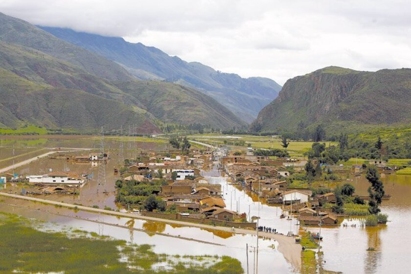 An area of Cuzco, Peru, was flooded Jan. 27 by the rain-swollen Huatanay River. Heavy downpours and mudslides in the country also blocked the train route to the ancient Inca citadel of Machu Picchu, stranding many tourists. The drenching is a typical El Niño pattern.