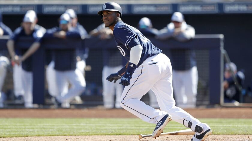 Franchy Cordero hits a single during a spring training game against the Los Angeles Angels.