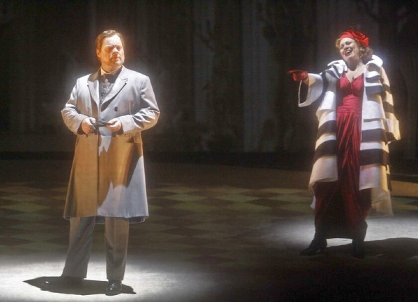 """In L.A. Opera's production of Franz Schreker's """"The Stigmatized,"""" Anja Kampe is the apex of a romantic triangle that includes Martin Ganter's count."""