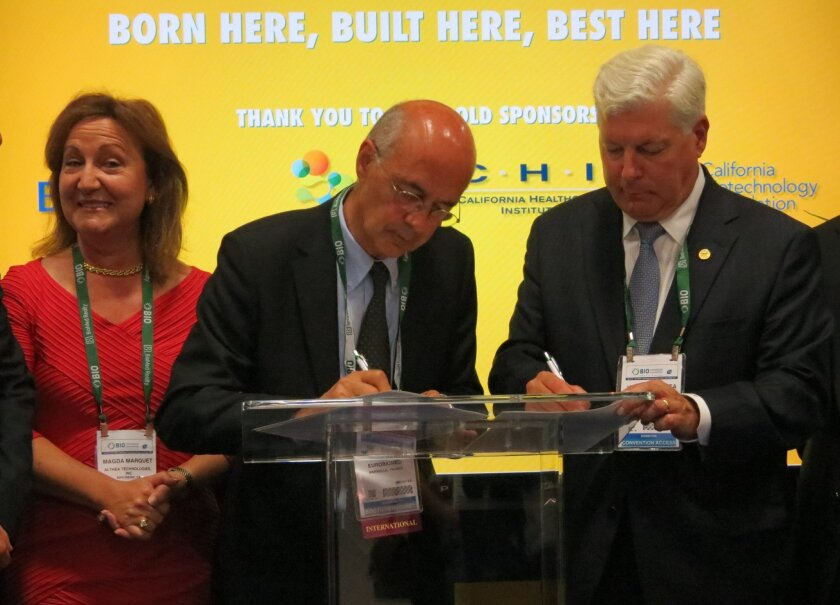 Officials of San Diego's Biocom and Eurobiomed, an agency in southeastern Francce, sign an agreement to help biotech companies do business in each other's regions. From left, Magda Marquet, founder of Althea Technologies and chair of Biocom; Jacquie Berthe, president of Eurobiomed and a scientific