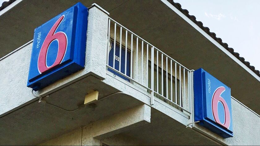 FILE - This Sept. 14, 2017 file photo shows a Motel 6 in Phoenix. A lawsuit filed Tuesday, Jan. 23,
